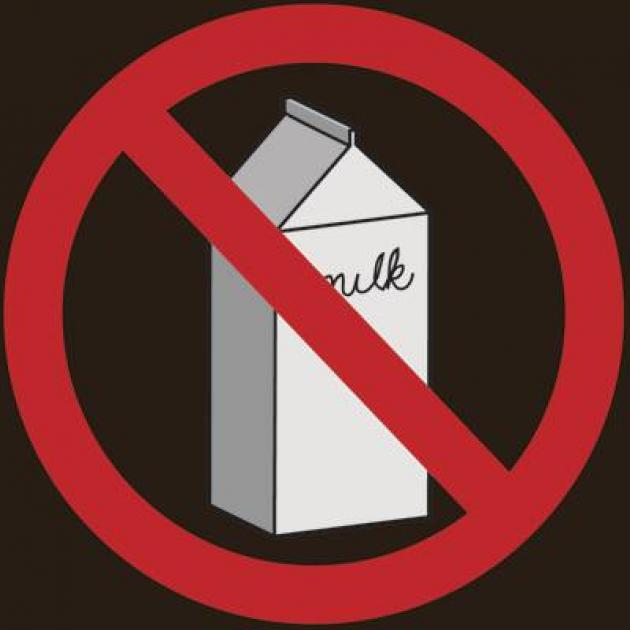 "Drawing of a carton with the word milk on it and a red circle with line through it as in the ""no"" symbol against a black background"