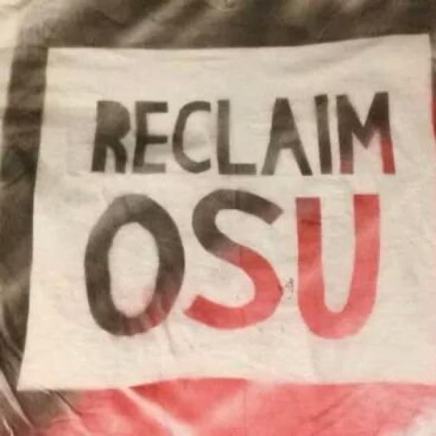 A sign that says Reclaim OSU