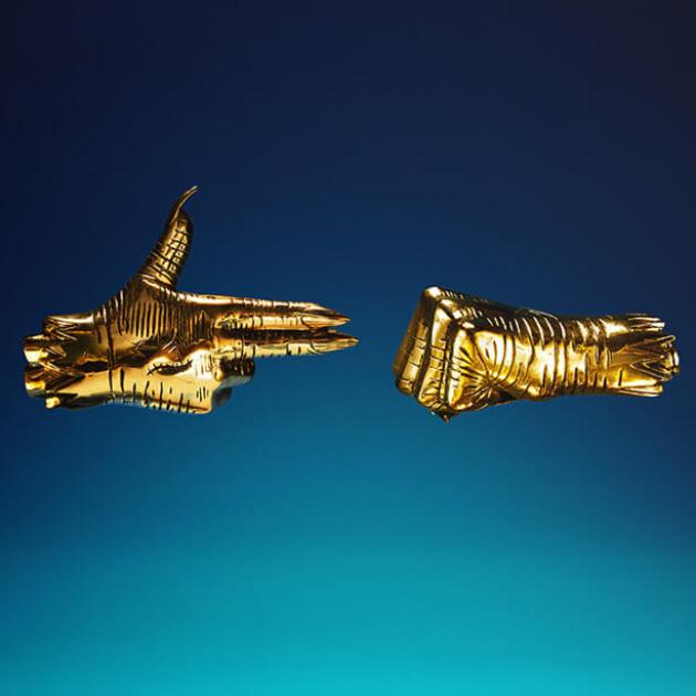 Two gold hands one in a fist one like a gun pointing at each other