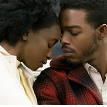 Black man and woman with eyes closed leaning their foreheads against each other