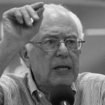 Black and white photo of Bernie Sanders gesturing as he talks