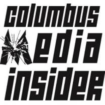 Black words Columbus Media Insider with the M looking like broken  glass