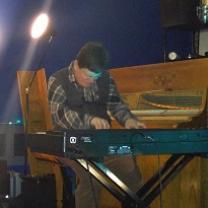 White man playing keyboards