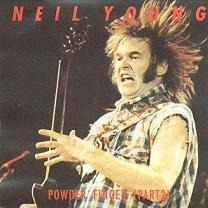 Man playing a guitar with his hair sticking straight up in the air and his face in a strange scowl he's wearing a plaid shirt without sleeves and he has long sideburns, the name Neil Young in red letters at top and Powderfinger below