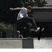 Boy doing a jump n a skateboard over a railing