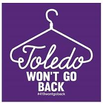 Purple background with drawing of white clothes hanger going into the word Toledo as the bottom of the hanger and then the words WON'T GO Back