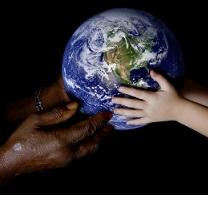Black hands at left and white hands at right both holding an Earth globe in the middle