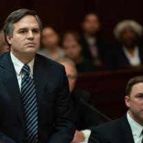 White guy in a suit looking serious