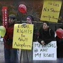 People outside holding protest signs saying Equal Rights for Adult Adoptees