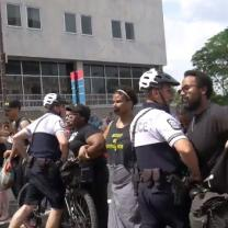 Police up in the face of black people in the street