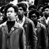 Black Panthers in berets in black and white photo