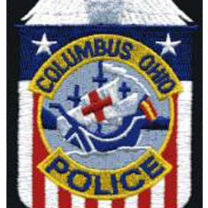 Badge with Santa Maria in center and red/white/blue background saying Columbus Ohio Police