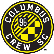 Round circle with mostly black background words Columbus Crew SC around the edges and in the middle a yellow checkered and striped symbol with a 96 on it