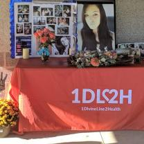 A table with memorial items from Bobbie Simpson and a table with the logo from 1DIVINELINE2HEALTH