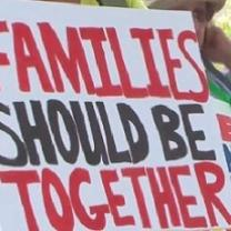 Sign saying families should be together