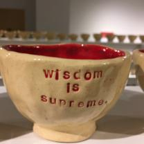 Coffee mug that says Wisdom is something