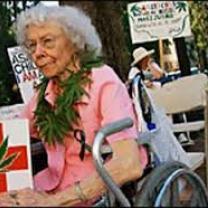 Elderly woman with marijuana sign