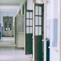 Hallway with lots of doors open