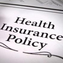 Words Health Insurance Policy with a squiggly line below