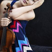 Young woman posing with a violin