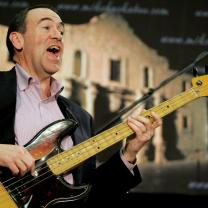 Mike Huckabee playing the bass guitar