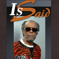 Black man with gray hair and sunglasses and the words Is Said
