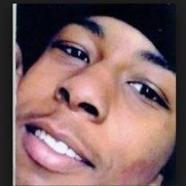 Young black man closeup of his face smiling
