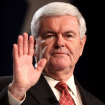 Older white haired man making a face and holding his hand up facing out in front of his face