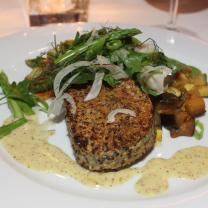 Quinoa and potato cake with fennel salad and roasted vegetables.