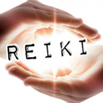 Two hands one on top one on bottom like they are holding the word Reiki which is glowing