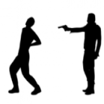 Silhouette of a man shooting another man