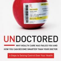 Cover of Undoctored book, with an apple with a prescription pasted on it