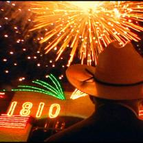 Fireworks and a guy in cowboy hat