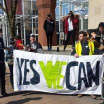 People holding Yes We Can sign
