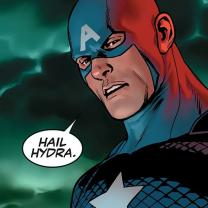 "Guy dressed as superhero with star on chest and big A on forehead mask standing against stormy sky saying in a word bubble ""Hail Hydra"""