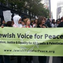 People marching with Jewish Voice for Peace banner