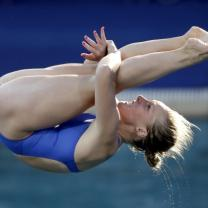 Woman in bathing suit doing a flip in a dive