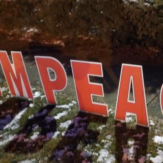 Word IMPEACH in big red letters