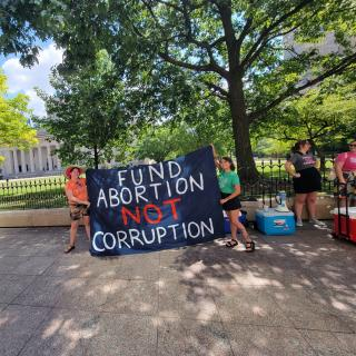 Sign saying Fund Abortion not Corruption