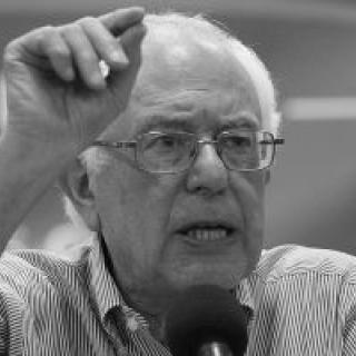 Black and white photo of Bernie Sanders gesturing as he talks