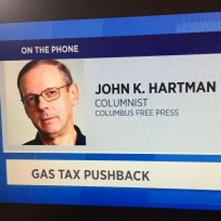 Screen shot of white man's head and the words John K. Hartman Columnist Columbus Free Press on the phone Gas Tax Pushback