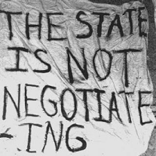 White banner with words The State is not negotiating