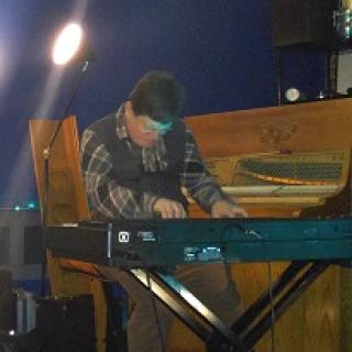 White man playing keyboards