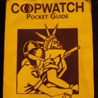 Yellow pamphlet with words Copwatch Pocket Guide at top and a drawing of two cops apprehending the Statue of Liberty