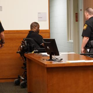 Man in wheelchair in police station