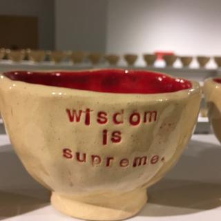 Coffee mug that says Wisdom is something