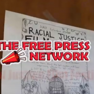 Newspaper saying Racial Justice and the words Free Press Network on top in red with a red bullhorn