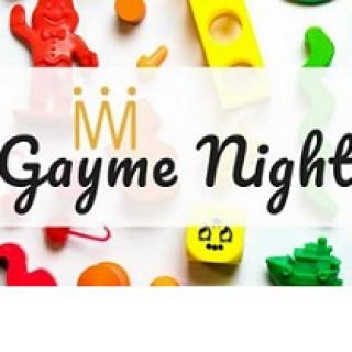 Colorful toys in the background and words in script in front Gayme Night