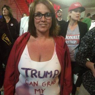 Woman wearing Trump can grab my...