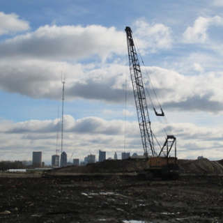 Crane over property with skyline in background